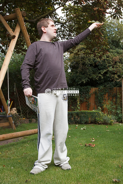 Young man with autism in garden. Cleared for Mental Health issues.