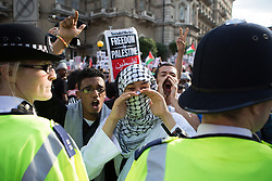 Image ©Licensed to i-Images Picture Agency. 15/07/2014. London, United Kingdom. Demonstration against BBC Israel-Palestine reporting. A demonstrator against Israeli strikes on Gaza shouts in front of the BBC in a demonstration against their way of reporting the conflict. the BBC. Picture by Daniel Leal-Olivas / i-Images