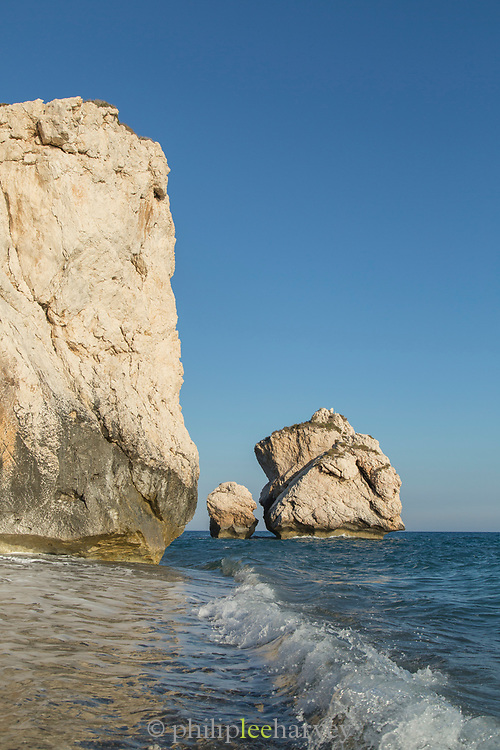 Scenic view of sea coastline with rock formations against clear sky, Paphos, Cyprus