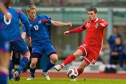 REYKJAVIK, ICELAND - Wednesday, May 28, 2008: Wales' Jason Koumas and Iceland's Gunnar Heidar Thorvaldsson during the international friendly match at the Laugardalsvollur Stadium. (Photo by David Rawcliffe/Propaganda)