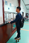 SHENYANG, CHINA - MARCH 28: (CHINA OUT)<br /> <br /> Man Has One Leg Shorter 23 CM Than The Other<br /> <br /> 27-year-old Zhao Qiang takes exercise on March 28, 2014 in Shenyang, Liaoning Province of China. Zhao had multiple chondroma when he was 2-year-old which made his left leg grow slower than the right one,  Zhao got an idea to wear a wooden bench on his left leg to keep balance. Hear has been wearing the wooden bench for 14 years. <br /> ©Exclusivepix