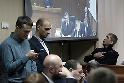 November 25, 2016 - Kiev, Ukraine - Former Ukrainian president Viktor Yanukovych is seen on a screen by via live video link from Russia,as he attends a hearing during a trial session in a district court in Kiev, Ukraine, 25 November 2016. Svyatoshinsky District Court of Kyiv held a hearing in the case of the Maidan events, questioning witness Ukrainian former Viktor Yanukovych(C) in the case of five former Berkut riot police officers, who are accused of murdering Maidan activists in February 2014. (Credit Image: © Serg Glovny via ZUMA Wire)