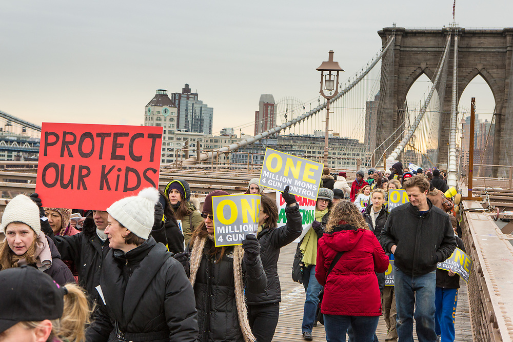 Marchers with placards on the Brooklyn Bridge.