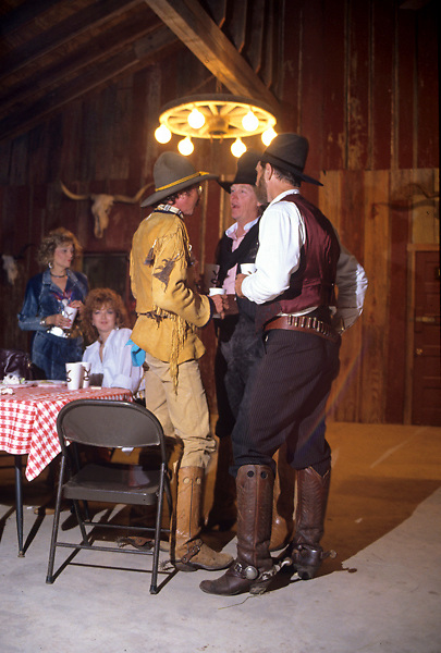 Cowboys taking a break at a square dance.
