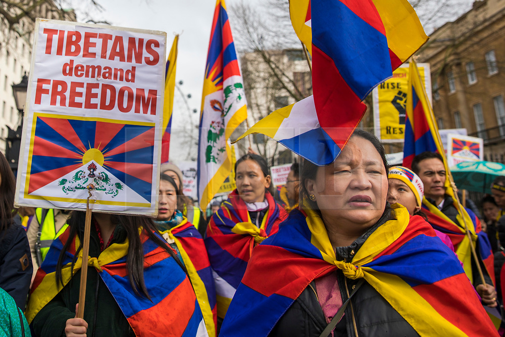 © Licensed to London News Pictures. 10/03/2018. London, UK. Members and supporters of the Tibetan refugee community join a rally on Whitehall to commemorate Tibetan Uprising Day, which took place on 10 March 1959. Photo credit: Rob Pinney/LNP