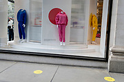 Days before the third Coronavirus lockdown ends, and non-essential retailers and shops re-open again, a woman shoppers looks in the window of the Selfridges department store on Oxford Street, on 9th April 2021, in London, England.