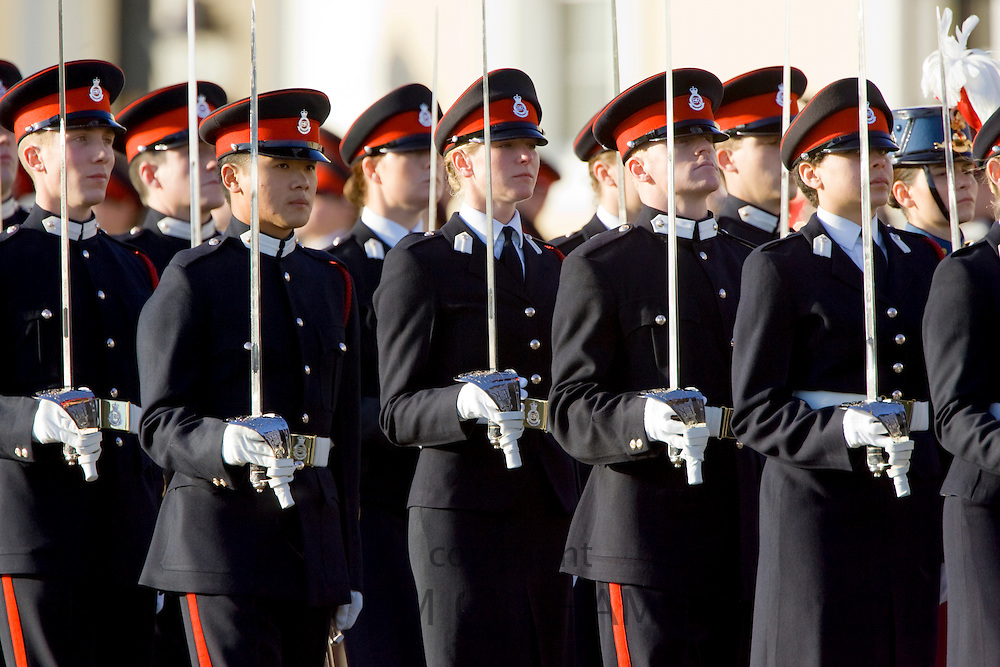 Male and female soldiers in military dress uniform on parade at Sandhurst Military Academy