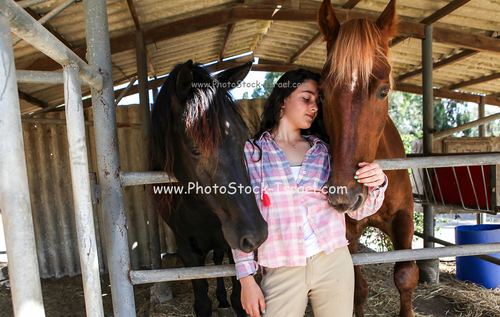 Teen cares for her horse