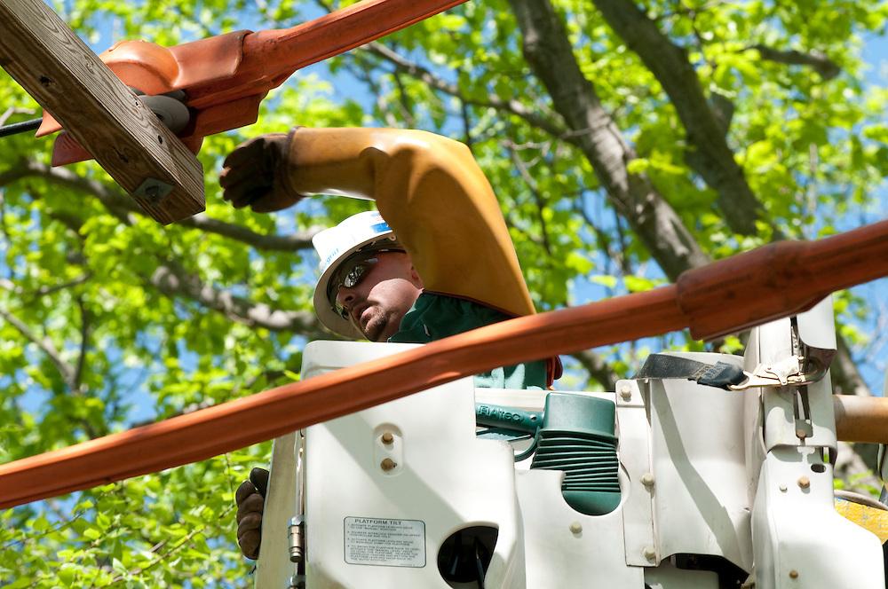 Over head power line worker.