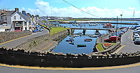 GV, general view, harbour,Portrush, Co Antrim, N Ireland, UK, taken from Ramore head. 201406213153<br /> <br /> Copyright Image from Victor Patterson, 54 Dorchester Park, Belfast, UK, BT9 6RJ<br /> <br /> Tel: +44 28 9066 1296<br /> Mob: +44 7802 353836<br /> Voicemail +44 20 8816 7153<br /> w: victorpatterson.com<br /> <br /> e1: victorpatterson@me.com<br /> e2: victorpatterson@gmail.com<br /> <br /> <br /> IMPORTANT: Please see my Terms and Conditions of Use at www.victorpatterson.com