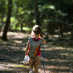 A young girl goes hiking in North Hampton New Hampshire USA