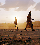 Locals passing by at Lalibela, Ethiopia.