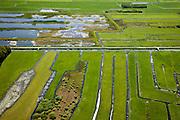 Nederland, Noord-Holland, Gemeente Wijdemeren, 25-05-2010; Oostelijke Binnenpolder van Tienhoven. Bij het winnen van veen (vervening) ontstaan petgaten of trekgaten die in de loop der eeuwen dichtgegroeid zijn. Door deze begroeiing  weg te halen onstaat weer het (oorspronkelijke) trilveen. Project van de vereniging Natuurmonumenten..luchtfoto (toeslag), aerial photo (additional fee required).foto/photo Siebe Swart