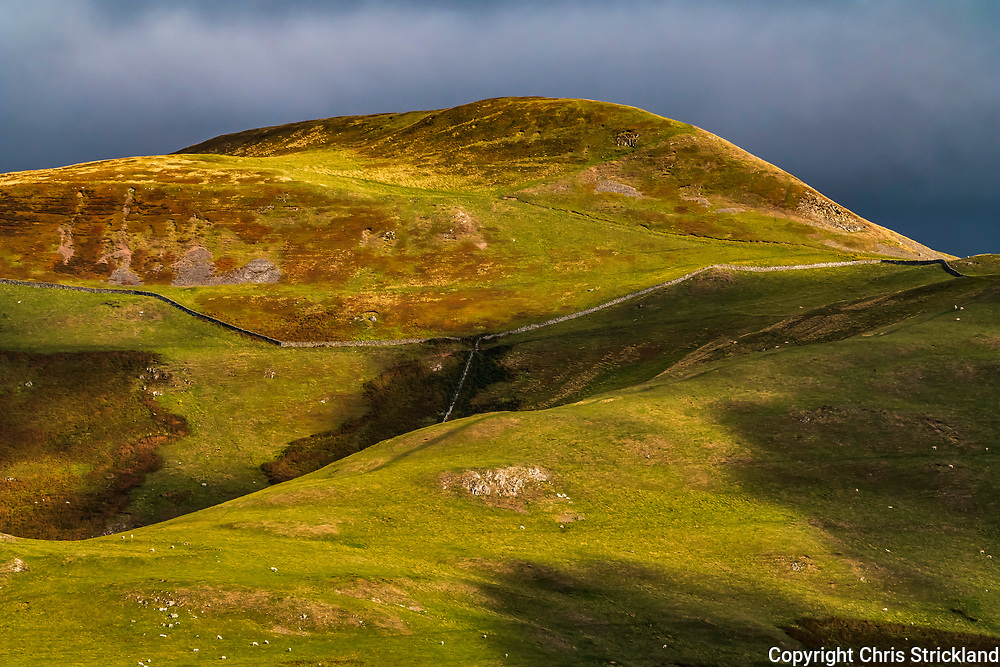 Hownam, Kelso, Scottish Borders, UK. 26th September 2018. Evening autumn light and shadows blow across the landscape of Hownam Law (449m) on the Scottish side of the Cheviot Hills.