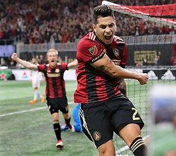 March 11, 2018 - Atlanta, GA, USA - Atlanta United player Franco Escobar (right) and midfielder Jeff Larentowiz react as teammate Hector Villalba scores a goal against D.C. United for a 3-0 lead in the home opener during the second half on Sunday, March 11, 2018, in Atlanta, Ga. Atlanta United won the game 3-1. (Credit Image: © Curtis Compton/TNS via ZUMA Wire)