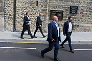 Businessmen walk along St. Mary Axe street in the City of London, the capital's financial district, on 10th May 2019, in London, England.
