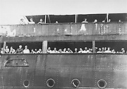 Jewish refugees aboard the 'SS St Louis' attempt to communicate with friends and relatives in Cuba, who were permitted to approach the docked vessel in small boats. The passengers werenot allowed to disembark.