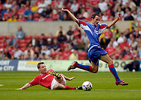 Photo: Leigh Quinnell.<br /> Nottingham Forest v Carlisle United. Coca Cola League 1. 16/09/2006. Carlisles David Raven is sent flying by a challenge from Forests Neil Harris.
