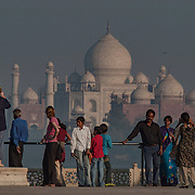 Indian tourists gather in front of the Taj Mahal as viewed from Agra Fort, Agra, India.