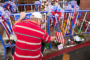 """15 JANUARY 2010 - TUCSON, AZ:    People visit the memorial for victims of the mass shooting in Tucson, AZ, Saturday, January 15, one week after the shooting. Six people were killed and 14 injured in the shooting spree at a """"Congress on Your Corner"""" event hosted by Arizona Congresswoman Gabrielle Giffords at a Safeway grocery store in north Tucson on January 8. Congresswoman Giffords, the intended target of the attack, was shot in the head and seriously injured in the attack but is recovering. Doctors announced that they removed her breathing tube Saturday, one week after the attack. The alleged gunman, Jared Lee Loughner, was wrestled to the ground by bystanders when he stopped shooting to reload the Glock 19 semi-automatic pistol. Loughner is currently in federal custody at a medium security prison near Phoenix. PHOTO BY JACK KURTZ"""
