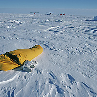 ANTARCTICA. Ski mountaineer sleeps outside at Patriot Hills Tourist Expedition Base at 80 degrees south latitude in the Ellsworth Mountains.