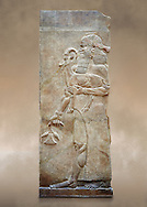 Stone relief sculptured panel of a man holding an Ibex and poppy seed pods. Facade N. Inv AO 19872 from Dur Sharrukin the palace of Assyrian king Sargon II at Khorsabad, 713-706 BC.  Louvre Museum Room 4 , Paris .<br /> <br /> If you prefer to buy from our ALAMY PHOTO LIBRARY  Collection visit : https://www.alamy.com/portfolio/paul-williams-funkystock/ancient-assyria-antiquities.html  Refine search by adding background colour, place, subject, museum etc into the LOWER SEARCH WITHIN GALLERY box to <br /> <br /> Visit our ANCIENT WORLD PHOTO COLLECTIONS for more photos to download or buy as wall art prints https://funkystock.photoshelter.com/gallery-collection/Ancient-World-Art-Antiquities-Historic-Sites-Pictures-Images-of/C00006u26yqSkDOM