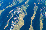 Aerial photograph of houses built on the ridges above Honolulu, Oahu, Hawaii