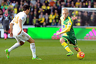 Norwich's Steven Naismith (r) looks to go past Swansea's Jack Cork. Barclays Premier league match, Swansea city v Norwich city at the Liberty Stadium in Swansea, South Wales on Saturday 5th March 2016.<br /> pic by  Carl Robertson, Andrew Orchard sports photography.