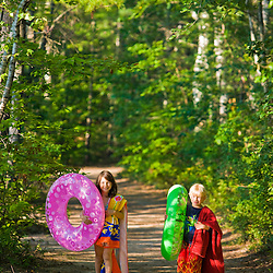 Kids walk to the beach at White Lake State Park in Tamworth, New Hampshire.