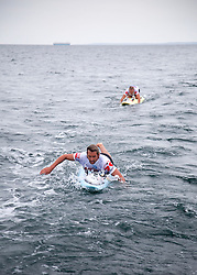 © Licensed to London News Pictures. English Channel. UK 27/07/2011. Nick Thorn (Front) and Dave Manley (Back) pictured. Surf Relief UK paddlers Dave Manley, Nick Thorn, Phil Williams and Toby Lowe paddle surf boards across the 22 miles of the English Channel from Shakespeare Beach, Dover to Cap Gris Nez in France yesterday (26/07/2011). The team smashed their previous predicted 6 hour time, crossing in 5 hours 20 minutes. The team will raise more than £3000 for Surf Relief UK which provides surfing lessoms for disabled and disadvantaged children across the UK. Photo credit: Manu Palomeque/LNP