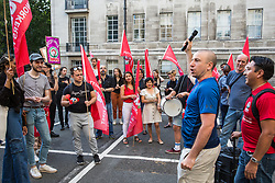 London, UK. 12 July, 2019. Outsourced workers based at the University of London and their supporters listen to Jason Moyer-Lee, General Secretary of the IWGB (Independent Workers of Great Britain) trade union, during a protest outside Senate House arranged after they failed to arrange a meeting with the university's new Vice-Chancellor Wendy Thomson. Credit: Mark Kerrison/Alamy Live News