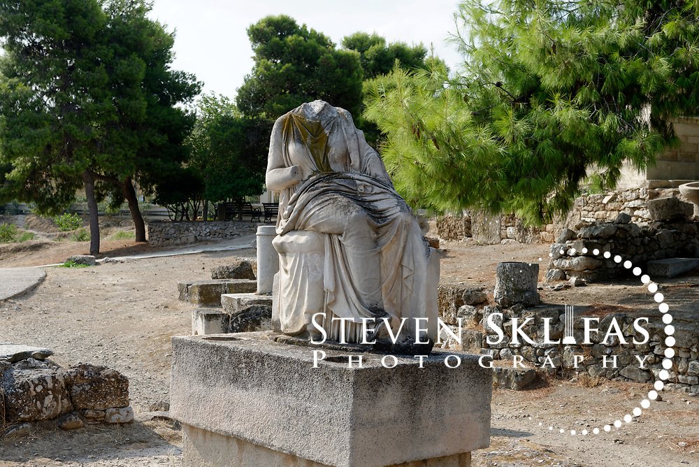 Unknown grave relief of a woman. Street of the Tombs. Kerameikos. Athens. Greece. The relief sculpture is located on the Street of the Tombs, which is the excavated part of the ancient main road to Piraeus. Serving as a burial ground as long ago as the 12th century BC, Kerameikos located in the ancient neighbourhood of potters contains part of the ancient city walls and the Dipylon, the main gate of Ancient Athens at a junction of the Sacred Way and Panathenaic Way. It served as a burial ground for the richest and most distinguished citizens of the city.