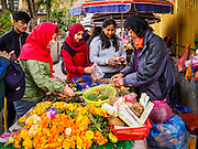 07 MARCH 2017 - KATHMANDU, NEPAL: People buy incense and marigolds to use for offerings at the Kamaladi Ganesh Temple, the most important Hindu temple dedicated to Ganesh, known as the overcomer of obstacles, in Kathmandu. In Hindu theology, Tuesdays are the best day to pray to Ganesh and the temple is very busy on Tuesdays. People frequently visit temples dedicated to Ganesh when they buy a new home or start a new job.     PHOTO BY JACK KURTZ