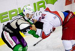 Ramzi Abid of Salzburg and Igor Cvetek of Olimpija in fight during ice-hockey match between HDD Tilia Olimpija Ljubljana (SLO) and EC Red Bull Salzburg (AUT) in 2nd Quaterfinals of EBEL league, on March 1, 2011 in Hala Tivoli, Ljubljana, Slovenia. (Photo By Vid Ponikvar / Sportida.com)