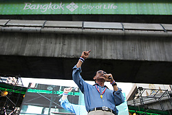 © Licensed to London News Pictures. 05/01/2014. An Anti-Government makes a speech during the third day of the 'Bangkok Shutdown' as anti-government protesters continue with their 'shutdown' of Bangkok.  Major intersections in the heart of the city have been blocked in their campaign to oust Prime Minister Yingluck Shinawatra and her government in Bangkok, Thailand. Photo credit : Asanka Brendon Ratnayake/LNP