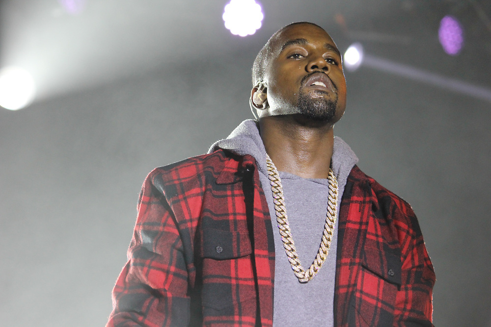 Kanye West performing at Common's AAHH! Fest at Chicago's Union Park on September 21, 2014.