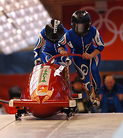 Photo: Catrine Gapper.<br />Winter Olympics, Turin 2006. Womens Bobsleigh. 21/02/2006. <br />Gerda Weissensteiner and Jennifer Isacco of Italy win the bronze medal.