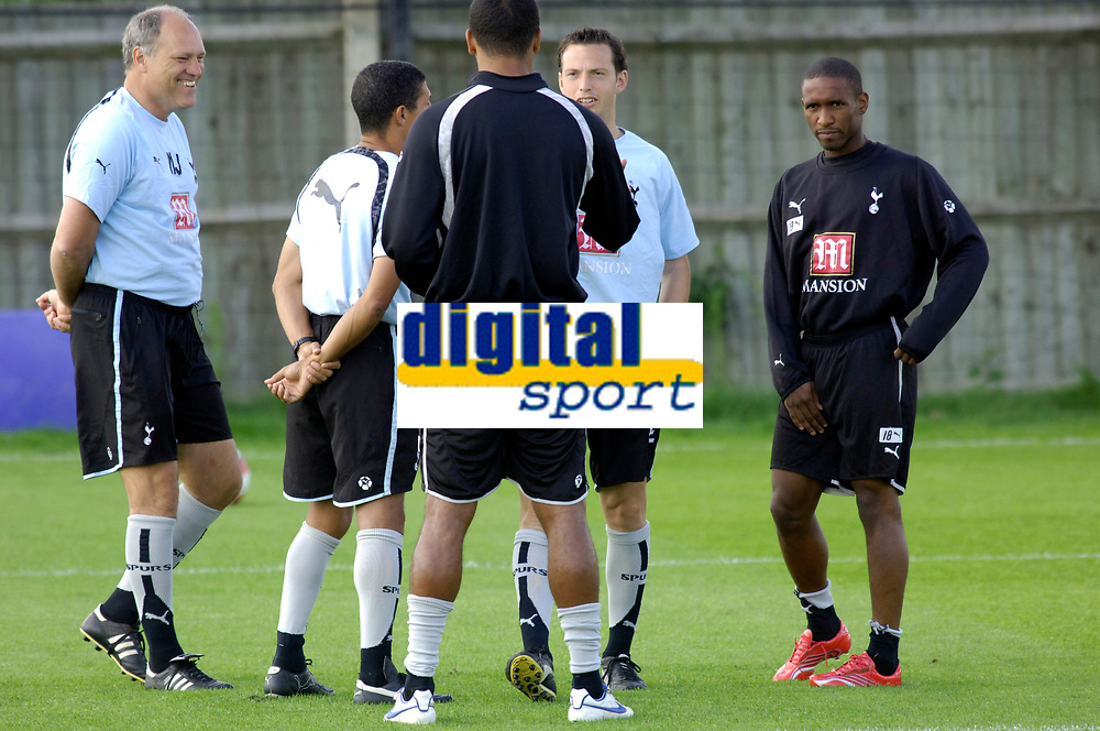 Photo: Daniel Hambury.<br />Tottenham Hotspur training session. 07/09/2006.<br />Manager Martin Jol (L) pictured during training with England striker Jermain Defoe on the far right hand side.