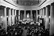 25/07/1962<br /> 07/25/1962<br /> 25 July 1962<br /> Consecration Rev. Dr Grimley S.M.A. as Bishop of Cape Palmas, Liberia at the Pro Cathedral, Dublin. Picture shows  a general view of the ceremony as the New Bishop, Very Rev. Dr. Nicholas Grimley S.M.A. (seated in front of the alter) is about to bless the congregation. President Eamon de Valera is seated in the centre of the church on the gospel side of the altar.