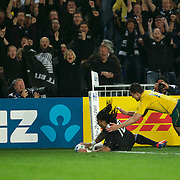 Ma'a Nonu scores New Zealand's only try as he avoids the tackle of Anthony Faingaa, Australia, during the New Zealand V Australia Semi Final match at the IRB Rugby World Cup tournament, Eden Park, Auckland, New Zealand, 16th October 2011. Photo Tim Clayton...