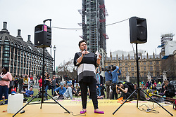 London, UK. 23rd April 2019. Tonia Antoniazzi, Labour MP for Gower, addresses climate change activists from Extinction Rebellion at an assembly in Parliament Square prior to an attempt to deliver to Parliament activists' letters requesting meetings to discuss climate change with their Members of Parliament.