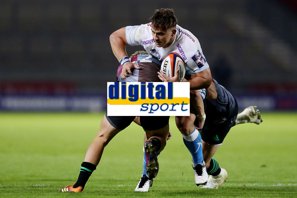 Rugby Union - 2019 / 2020 Premiership Rugby Cup - Final - Sale Sharks vs Harlequins<br /> <br /> Rohan Janse van Rensburg of Sale Sharks is tackled by Scott Baldwin and Luke Northmore of Harlequins, at the A J Bell Stadium.<br /> <br /> COLORSPORT/PAUL GREENWOOD