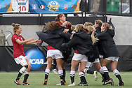 04 December 2011: Stanford's Teresa Noyola (top) is congratulated by teammates following her goal. The Stanford University Cardinal defeated the Duke University Blue Devils 1-0 at KSU Soccer Stadium in Kennesaw, Georgia in the NCAA Division I Women's Soccer College Cup Final.