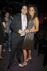 HARRY COLE and his sister OLIVIA COLE at a party hosted by Stephen Webster at the Alto Club, 15-21 Ganton Street, London on 2nd July 2009.