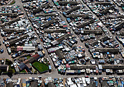 Old formal settlements for migration labour lose form to informal residents in Langa, near Cape Town, South Africa. Image by Greg Beadle