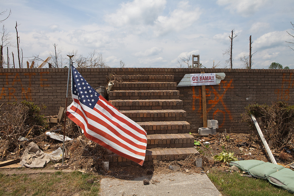 American flag and an anti-Obama sign in front of a home totaled by a tornado in Alabama.Pleasant Grove, a suburb of Birmingham<br />  Alabama <br /> remains in a state of ruin over two weeks after it was hit by an F-4 ( possibly an F-5) tornado, one of an estimated 300 that struck Alabama and the neighboring states on April 27th , 2011.