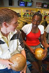 Teenagers at bowling.