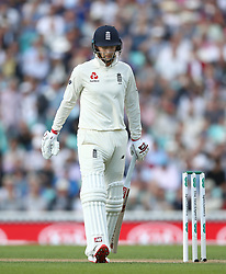 England's Joe Root looks dejected as he leaves the field after being given out for a duck from bowling by India's Jasprit Bumrah during the test match at The Kia Oval, London.