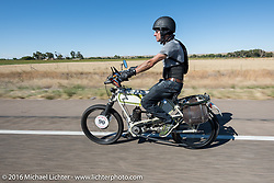 Steve Norton of England riding his single-speed, single-cylinder 1904 Rex class-1 bike through the eastern plains of Colorado during the Motorcycle Cannonball Race of the Century. Stage-9 Dodge City, KS to Pueblo, CO. USA. Monday September 19, 2016. Photography ©2016 Michael Lichter