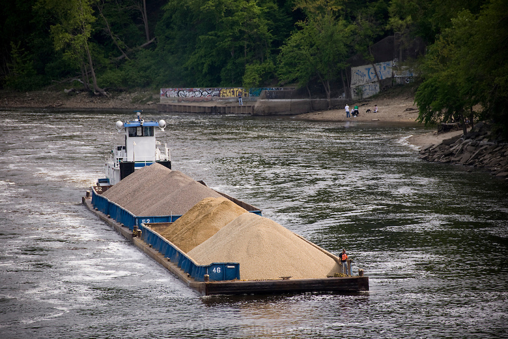 A barge ferries a load of gravel on the upper Mississippi river in Minneapolis, Minnesota.